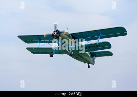 biplane Antonov-2 at the festival on the airfield celebrating 100 years of flying in Lueneburg, Lower Saxony, Germany - Stock Photo