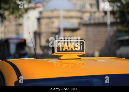 Yellow taxi car roof sign in Turkey - Stock Photo