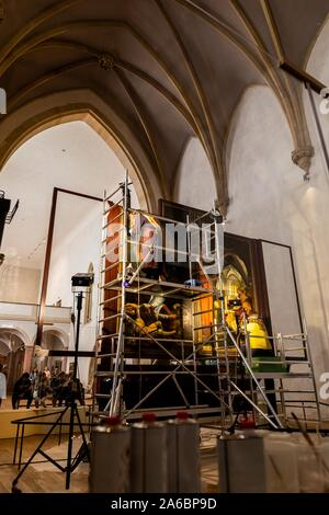 Colmar, France. 25th Oct, 2019. Two restorers are working on panels of the Isenheim altar in the Museé Unterlinden. The altar is currently undergoing extensive restoration. Credit: dpa picture alliance/Alamy Live News - Stock Photo