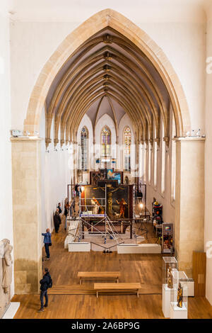 Colmar, France. 25th Oct, 2019. A scaffolding stands in front of a panel of the Isenheim altar in the Museé Unterlinden. The altar is currently undergoing extensive restoration. Credit: dpa picture alliance/Alamy Live News - Stock Photo