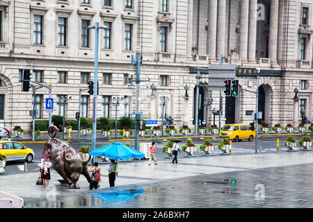 Arturo Di Modica's Charging Bull with HSBC building in background in the Bund district Shanghai Chine - Stock Photo