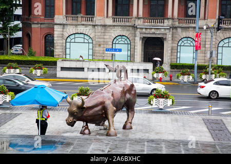 Arturo Di Modica's Charging Bull in the Bund district Shanghai Chine - Stock Photo