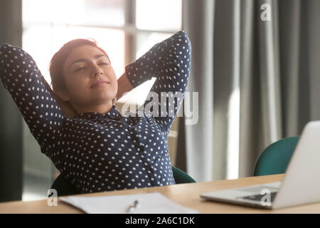 Millennial young indian woman relaxing after hard working day - Stock Photo