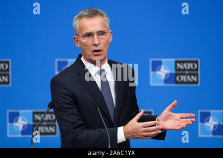 Brussels, Belgium. 25th Oct, 2019. NATO Secretary General Jens Stoltenberg speaks during the wrapping-up press conference of a two-day NATO (North Atlantic Treaty Organization) defense ministers' meeting at the NATO headquarters in Brussels, Belgium, Oct. 25, 2019. Credit: Zheng Huansong/Xinhua/Alamy Live News - Stock Photo