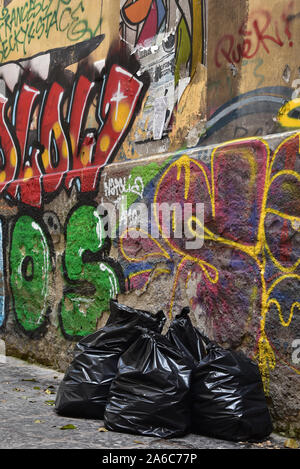 Graffiti and garbage - unfortunately, a typical scene in the city of Naples, Italy, Europe.