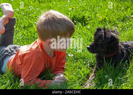 Portrait of a young boy and his dog. - Stock Photo