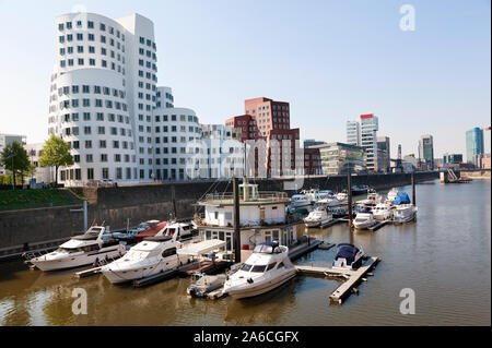 View of the Neuer Zollhof in Media Harbor and Rhein river in Dusseldorf city, North Rhine-Westphalia, Germany - Stock Photo