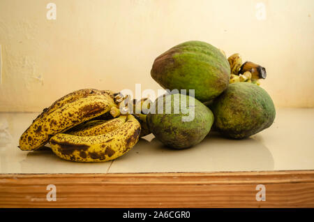 Pear And Ripe Bananas On White Background - Stock Photo