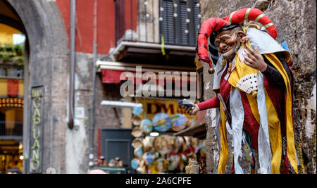 Napoli, Italy - December 5 2015: Market in San Gregorio Armeno, where artisans sell their statues or little objects related to the nativity scene. - Stock Photo