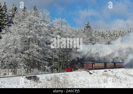 The steam train climbing Brocken Mountain near Drei Annen Hohne in the Harz Mountains, Germany. - Stock Photo