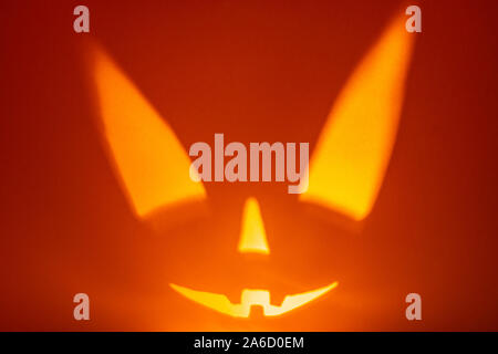 Character halloween scary face on red background. Scary smile face. Holiday horror background.