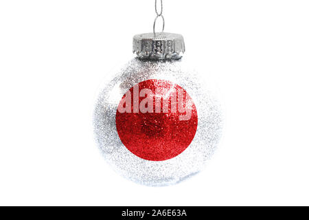 Glass Christmas ball toy isolated on white background with the flag of Japan - Stock Photo