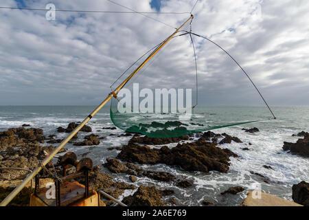 Net fishing gear along the atlantic coast in Le Pouliguen, Loire-Atlantique department, western France. - Stock Photo