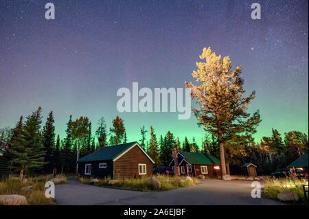 Aurora Borealis, Northern lights over wooden cottage in national park at Jasper, Canada