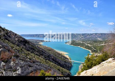 View of the lake of Sainte Croix an the bridge of Galetas entrance of the Verdon Gorges, Alpes de Haute Provence France - Stock Photo
