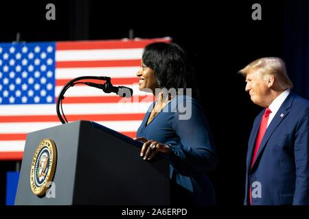 Colombia, United States of America. 25 October, 2019. U.S President Donald Trump listens as former inmate Tanesha Bannister, delivers remarks at the 2019 Second Step Presidential Justice Forum at Benedict College October 25, 2019 in Columbia, South Carolina. Bannister, who received a life sentence for a drug conviction, was released in May 2019 as a result of the First Step Act signed into law by Trump.  Credit: Shealah Craighead/White House Photo/Alamy Live News - Stock Photo