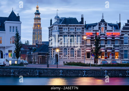 Middelburg, The Netherlands, october 10, 2019: view across the canal towards the town center with the Lange Jan church tower in the blue hour - Stock Photo