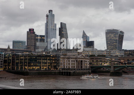 City of London General View GV from the Millennium Bridge in the early evening during autumn. - Stock Photo