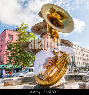 Cork City, Cork, Ireland. 26th October, 2019. Sousaphone player James Hobbis of Hyde Park Brass gets ready for  an impromptu performance for the public on Grand Parade during the Jazz Festival in Cork, Ireland. - Credit; David Creedon / Alamy Live News - Stock Photo