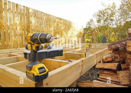 DeWalt Drill on a Frame from Raised Deck in Garden, DIY, Do It Yourself, Gardening, Garden Work - Stock Photo