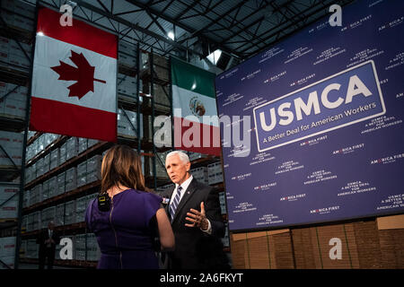 USA. Oct. 25, 2019. Vice President Mike Pence participates in an interview at a United States-Mexico-Canada Agreement event Wednesday, Oct. 23, 2019, at the Uline Distribution Warehouse in Pleasant Prairie, Wis People: Vice President Mike Pence Credit: Storms Media Group/Alamy Live News Credit: Storms Media Group/Alamy Live News - Stock Photo