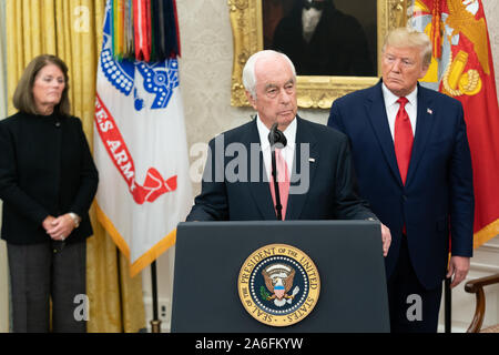Washington, United States Of America. 24th Oct, 2019. USA. Oct. 25, 2019. As President Donald J. Trump looks on, Presidential Medal of Freedom recipient Roger Penske delivers remarks Thursday, Oct. 24, 2019, in the Oval Office of the White House. People: President Donald J. Trump, Roger Penske Credit: Storms Media Group/Alamy Live News Credit: Storms Media Group/Alamy Live News - Stock Photo