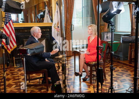Washington, United States Of America. 22nd Oct, 2019. USA. Oct. 25, 2019. Vice President Mike Pence participates in an interview with Laura Ingraham of FOX News Tuesday, Oct. 22, 2019, in the Vice PresidentÕs Ceremonial Office in the Eisenhower Executive Office Building of the White House. People: Vice President Mike Pence Credit: Storms Media Group/Alamy Live News Credit: Storms Media Group/Alamy Live News - Stock Photo