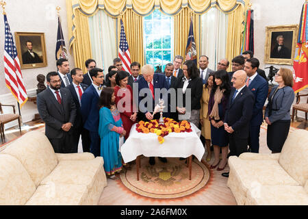 Washington, United States Of America. 24th Oct, 2019. USA. Oct. 25, 2019. President Donald J. Trump and guests participate in a Diwali ceremony and lighting of the Diya Thursday, Oct. 24, 2019, in the Oval Office of the White House. People: President Donald J. Trump Credit: Storms Media Group/Alamy Live News Credit: Storms Media Group/Alamy Live News - Stock Photo