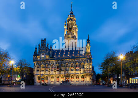 Illuminated townhall in medieval city Middelburg, The Netherlands - Stock Photo