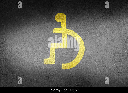 Disabled parking space, handicapped parking spot, the universal sign for people with wheelchairs and disabilities. Disabled badge holds, blue badge - Stock Photo