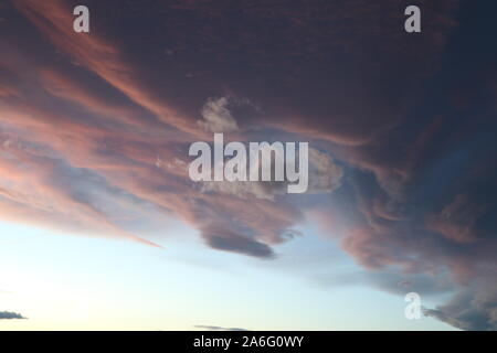 Colored clouds hovering in the sky during a Colorado Sunset - Stock Photo