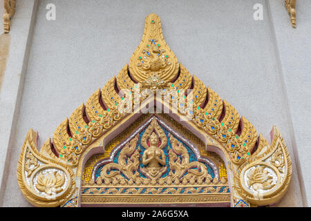 Ko Samui Island, Thailand - March 18, 2019: Wat Khunatam Buddhist Temple and monastery. Golden triangular decoration filled with colored gemstones abo - Stock Photo
