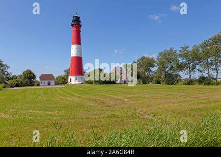 The lighthouse on Pellworm Island in North Friesland, Schleswig-Holstein, Germany. - Stock Photo