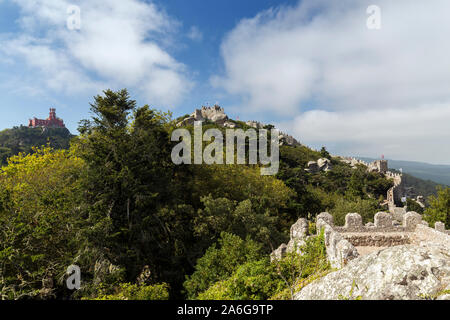 Scenic view of the Pena Palace (Palacio da Pena) and medieval hilltop castle Castelo dos Mouros (The Castle of the Moors) in Sintra, Portugal. - Stock Photo