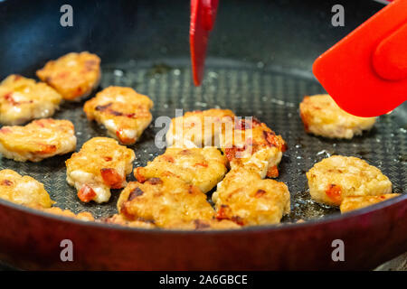 Round Chicken Cutlets Being Baked for Some Burgers for Wedding Meal on Pan with Blue Flames Under it - Kitchen Set, Concept of Delicious barbecue (BBQ - Stock Photo