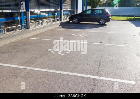 Disabled parking bays spaces in front of Lidl supermarket, Sopron, Hungary - Stock Photo
