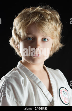A handsome young man in his karate gi, suit, - Stock Photo