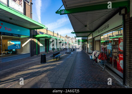 Barnardo's charity shop in a desolate shopping centre, virtually the only shop left, poverty, high street decline, empty shops - Stock Photo
