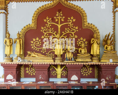 Ko Samui Island, Thailand - March 18, 2019: Wat Khunaram Buddhist Temple and monastery. Maroon Altar like display of several golden Buddha statues wit - Stock Photo