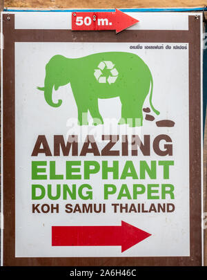 Ko Samui Island, Thailand - March 18, 2019: Wat Khunaram Buddhist Temple and monastery. Poster sign for sale of Elephant dung paper with image of the - Stock Photo