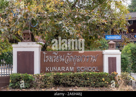 Ko Samui Island, Thailand - March 18, 2019: Wat Khunaram Buddhist Temple and monastery. Sign of the school at the sanctuary in front of garden and bui - Stock Photo