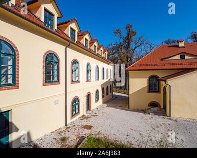 Demonstrative farm village property near Sneznik castle in Slovenia - Stock Photo