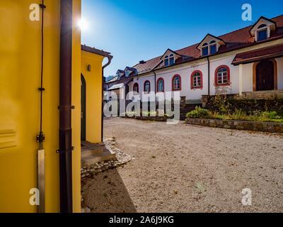 Demonstrative farm village property near Sneznik castle in Slovenia - Stock Photo