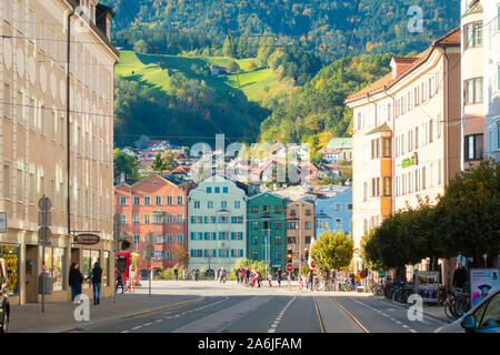 View from the old town to colourful houses of Mariahilf at the Inn in front of the Nordkette, Innsbruck, Tyrol, Austria. - Stock Photo