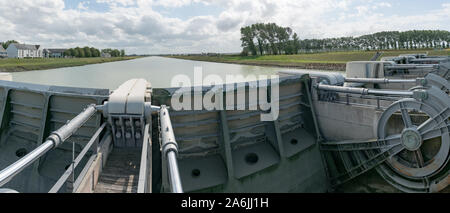 detail view of river locks and weir to regulate water flow in canal system Stock Photo