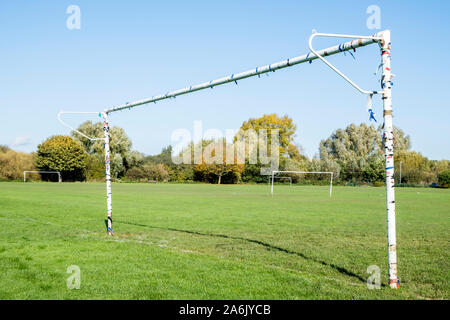 Old and well used metal goalpost on a playing field with other goalposts, Nottinghamshire, England, UK - Stock Photo