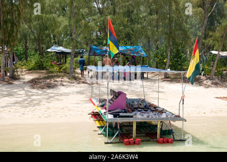 Mauritius beach stall; a boat stall selling crafts on the beach at Ile aux Benitiers, Le Morne, Mauritius