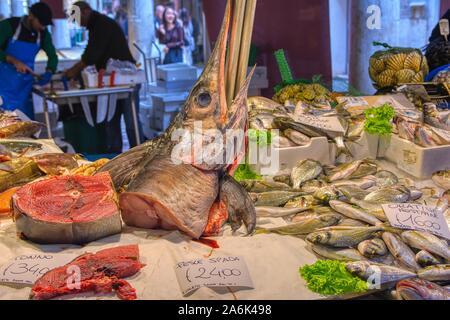 Venice, Italy - October 12, 2019: Fresh seafood for sale at the Rialto farmers market ,Mercato di Rialto, in Venice near the Rialto Bridge and the Gra