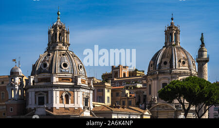 The view on dome of the Santa Maria di Loreto church and dome of the Church of the Most Holy Name of Mary at the Trajan Forum. - Stock Photo
