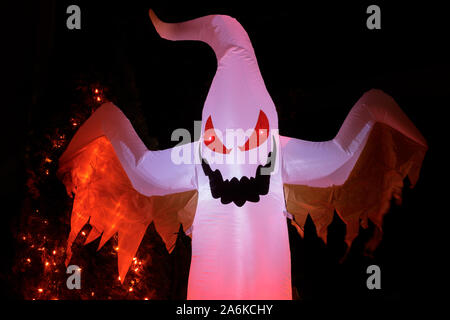 Inflatable Ghost Glowing in the Dark for Halloween Spirit - Stock Photo